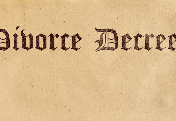 A divorce decree paper on the desk.